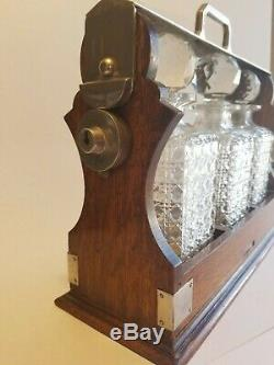 Abercrombie & Fitch Antique Tantalus Circa 1913 Oak Silver Plate 3 Bottle Cut Gl