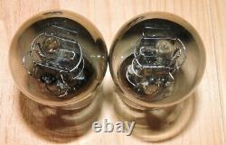 Matched pair PTT2 Ba clear glass tip black plate metal base around 1900 NOS